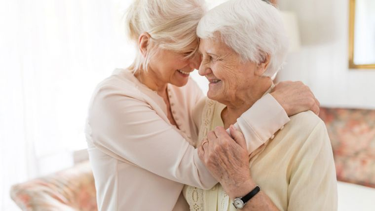 Elderly Woman Consoled